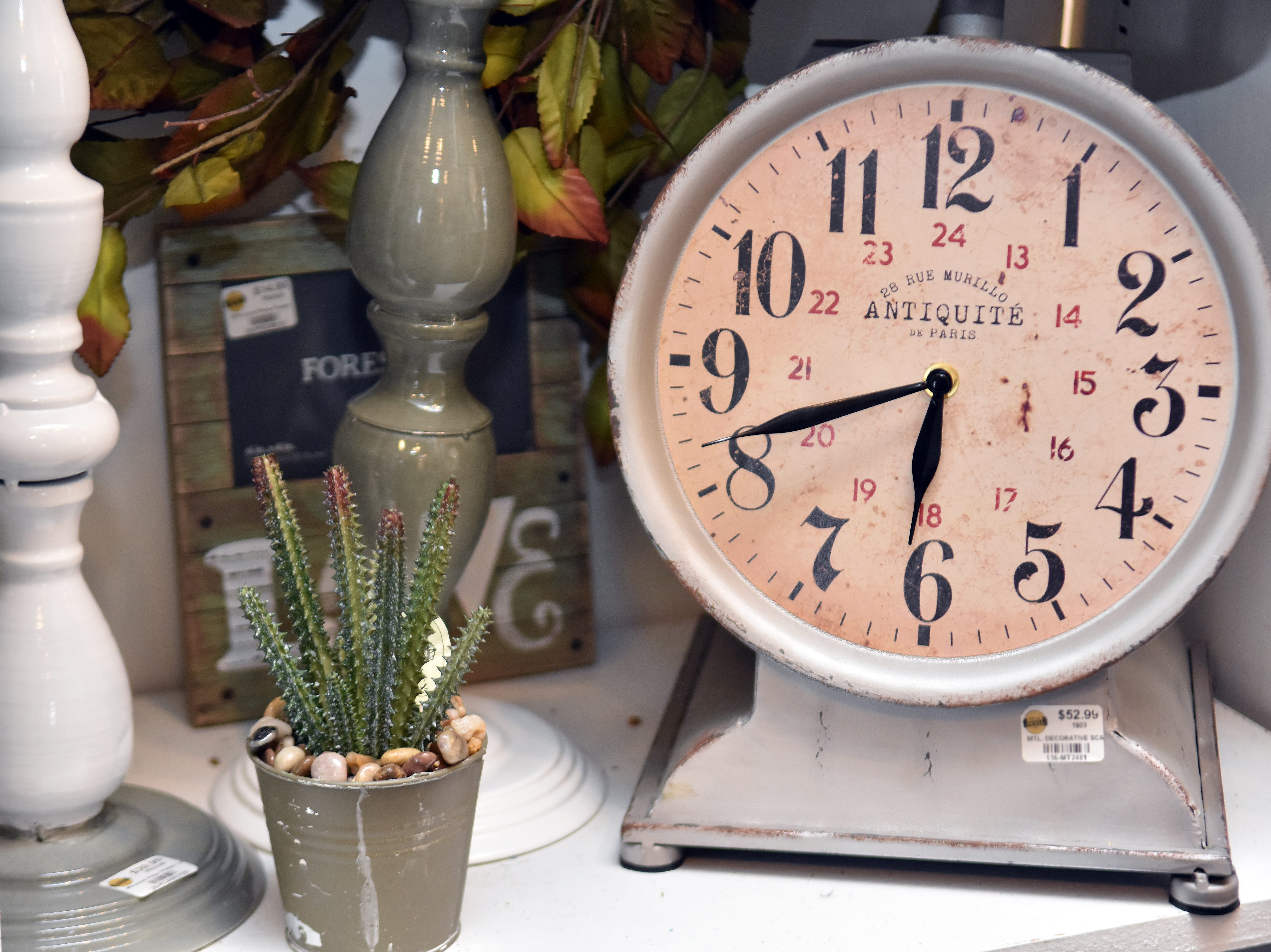 This scale with clock face creates a focal point in a home.