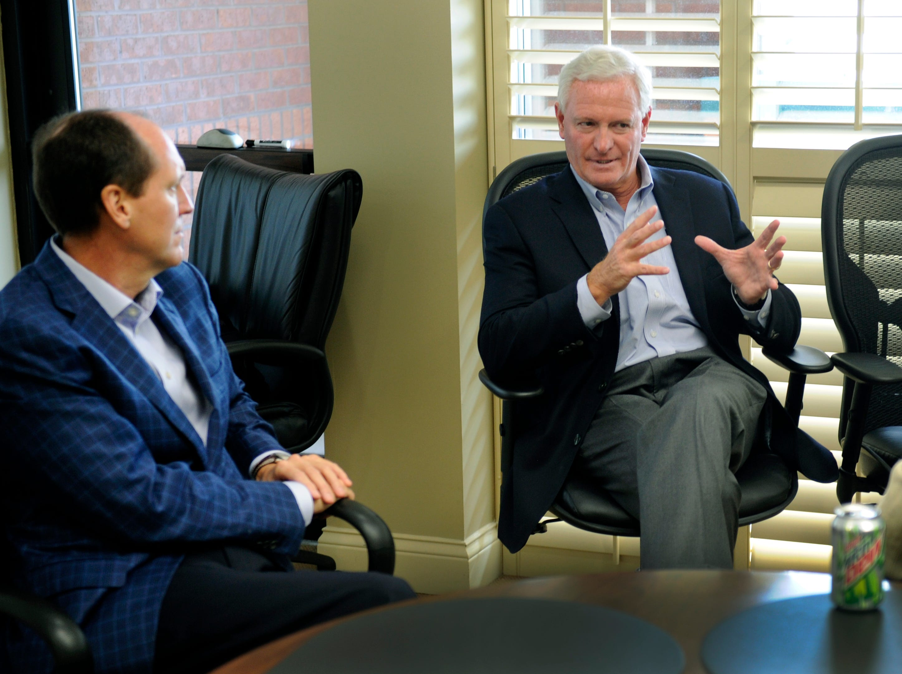Outgoing Pilot CEO Jimmy Haslam, center, talks to his sucessor, John Compton and his wife, Cindy, Thursday, Sep. 13, 2012 about schools and churches in the area.