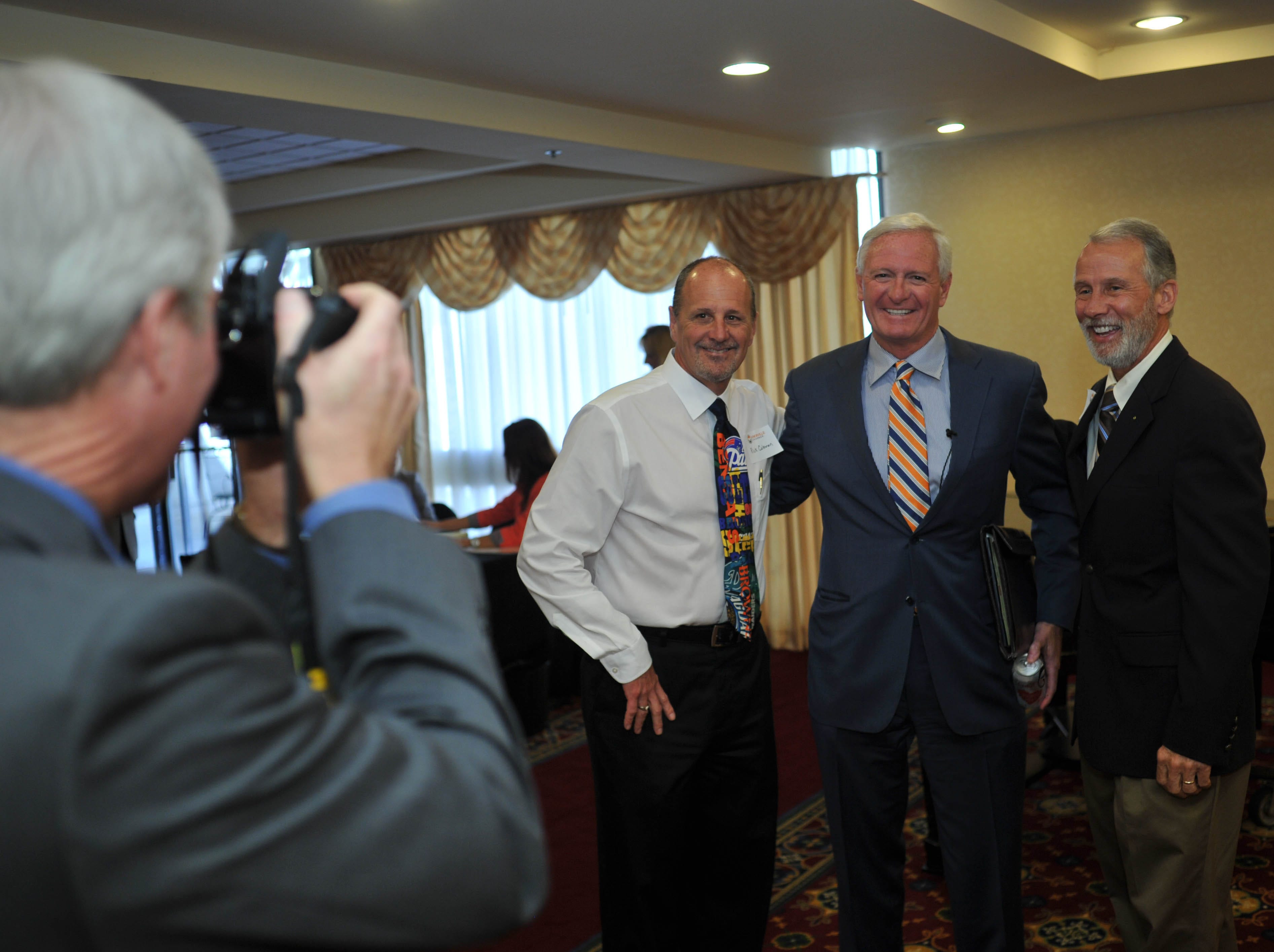 With YMCA of East Tennessee President Jim Dickson behind the lens, Pilot Flying J President and Cleveland Browns owner Jimmy Haslam, center, is photographed with YMCA CFO Rick Coleman, left, and Denark Construction Co. President Frank Rothermel before a Knoxville Chamber execUTive Speaker Series presentation Wednesday, April 10, 2013, at the Marriott.