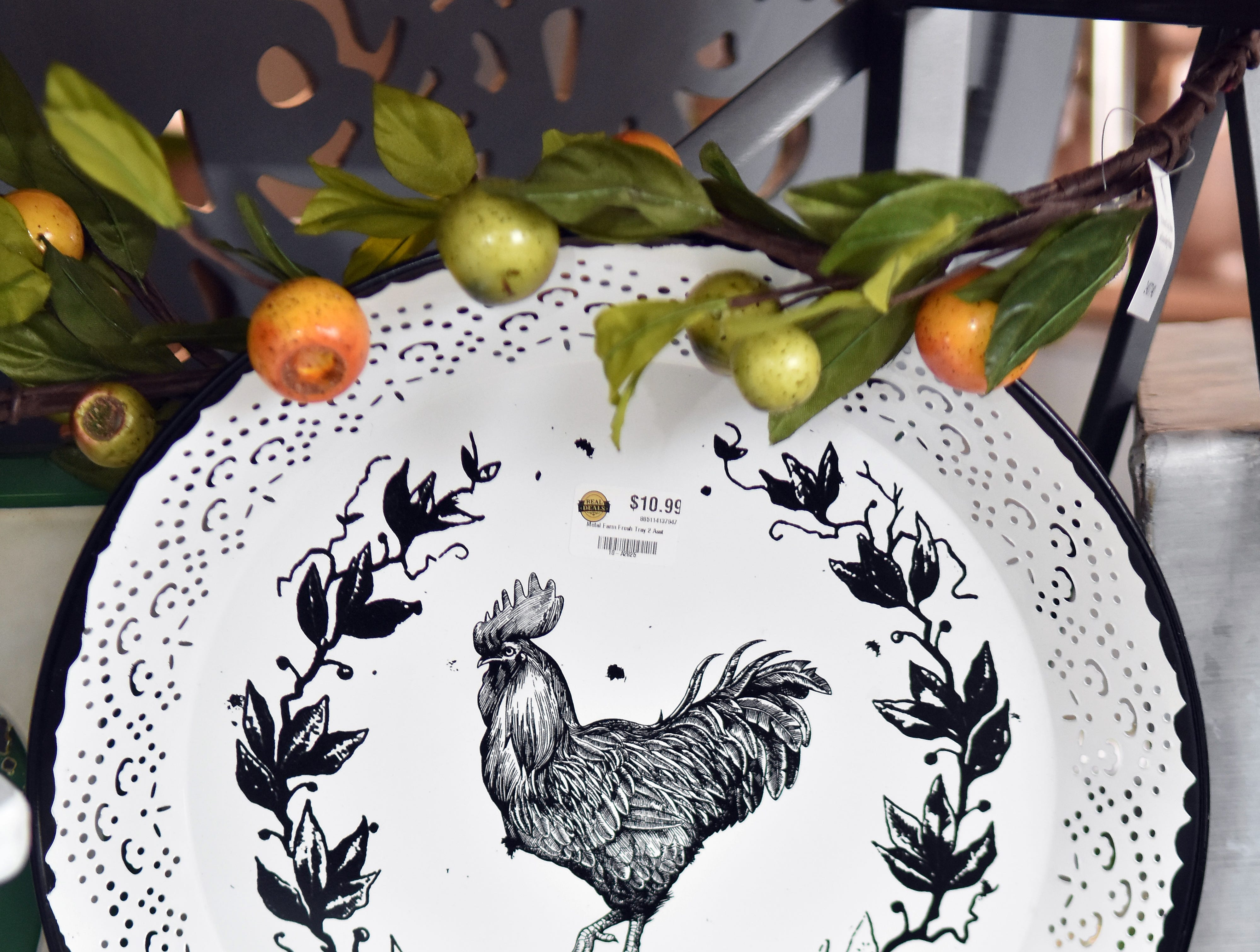 Kim Severence at Real Deals combines just a touch of color with this striking black and white rooster plate.