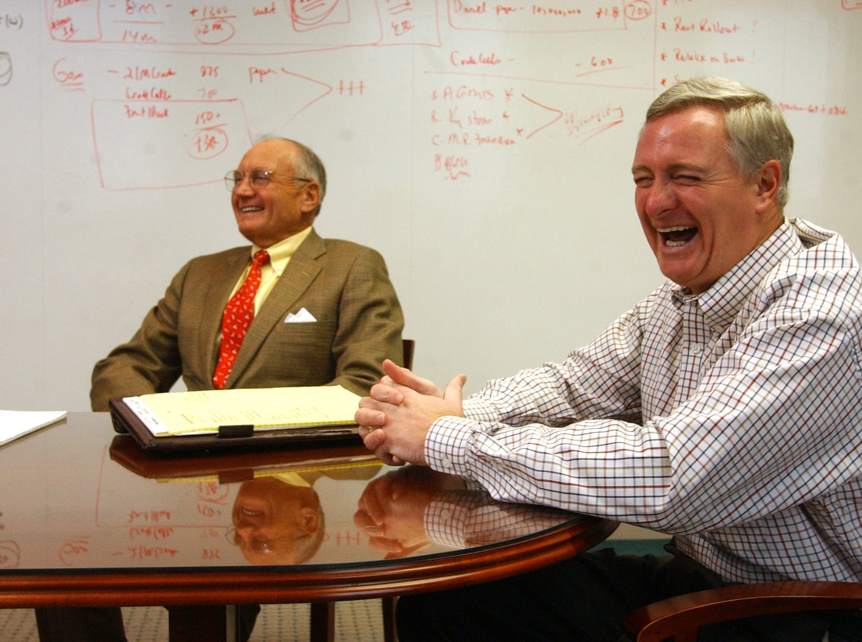Pilot Travel Centers LLC President Jimmy Haslam, right, with his father and Pilot  Corp. founder, Jim Haslam, talks about the $190 million deal to acquire 60 travel centers from rival Williams Travel Centers Inc. on July 23, 2001, at Pilot's Knoxville headquarters.