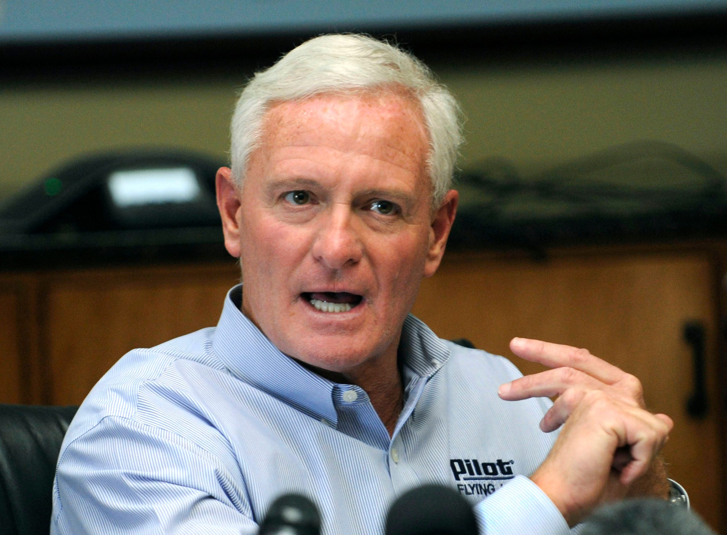 Jimmy Haslam announces he will stay on as the Pilot Flying J CEO during a news conference Friday at the company's Lonas Road headquarters. The announcement comes as Pilot Flying J faces intense pressure in connection with a FBI criminal investigation into claims of failure to pay rebates to trucking customers.