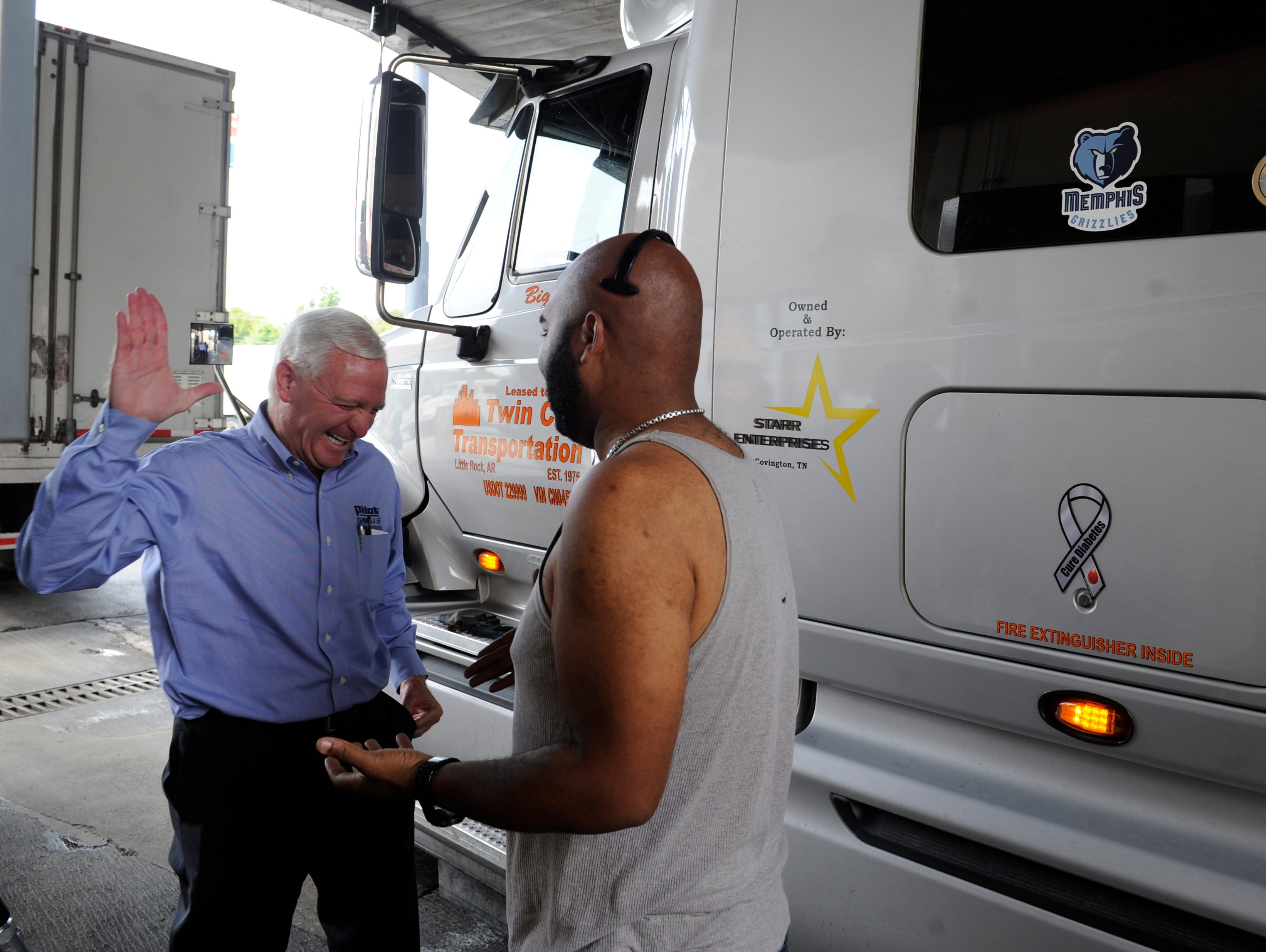 """Pilot CEO Jimmy Haslam visits with driver Prince Starr at the Pilot Travel Center off Lovell Road, Tuesday, Sept. 14, 2013. Pilot declared September """"Driver Appreciation Month"""", Mr. Haslam visits stores and greets customers three days a week."""