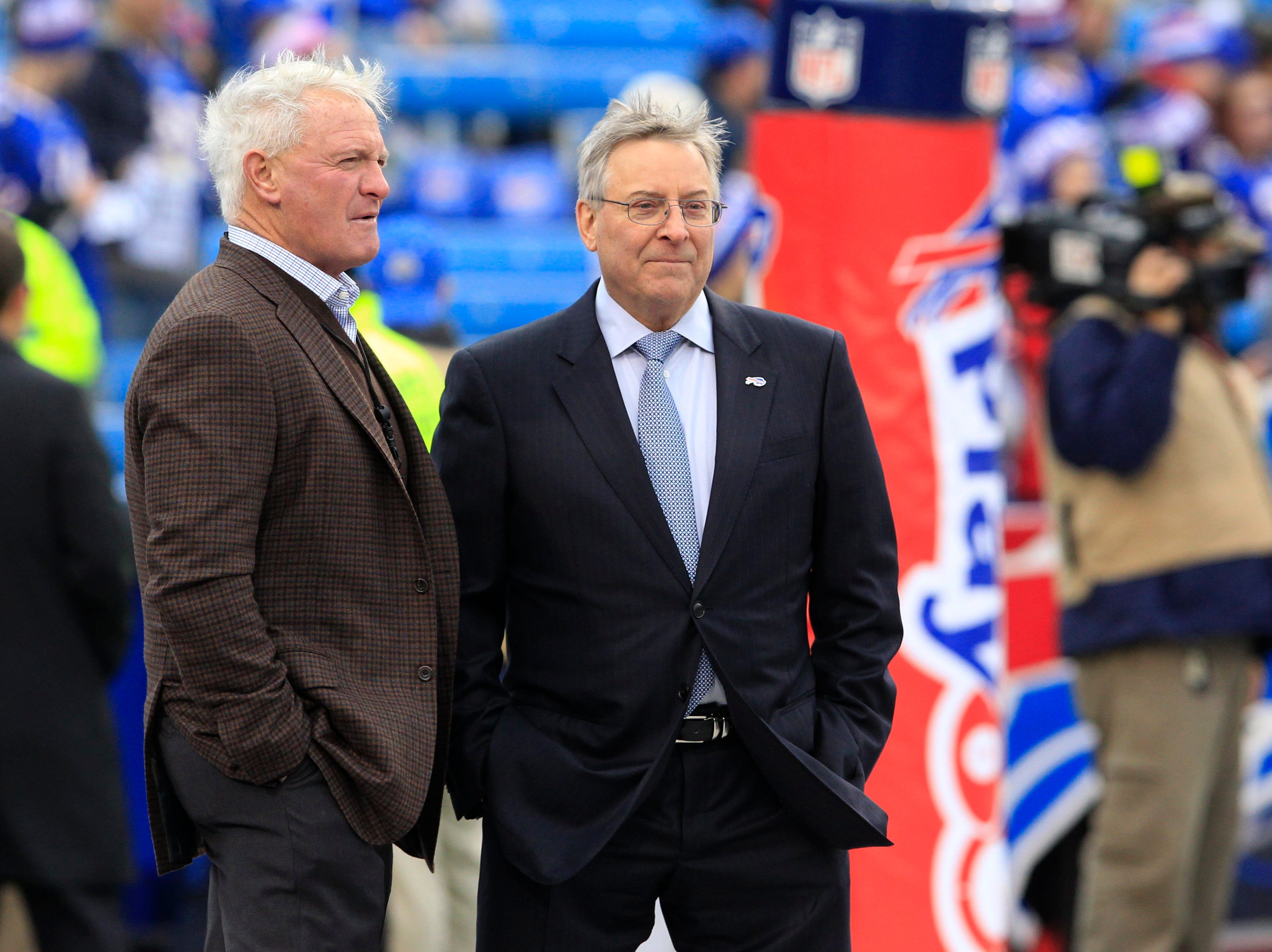 Buffalo Bills owner Terrence Pegula, right, talks to Cleveland Browns owner Jimmy Haslam prior to an NFL football game between their teams, Sunday, Nov. 30, 2014, in Orchard Park, N.J.