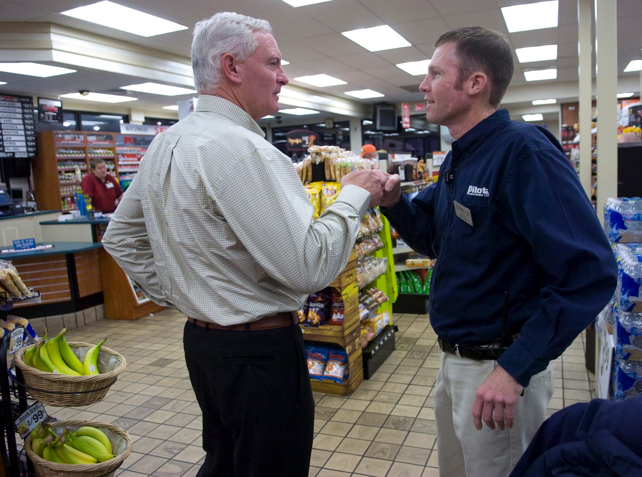 Jimmy Haslam (left), president and CEO of Pilot Travel Centers, visits with manager Jim Kennedy at the Flying J Travel center at Watt Road in Knoxville on Nov. 16, 2010. Pilot Travel Centers and Flying J merged in June of 2010, with the company now operating more than 550 travel centers across North America.