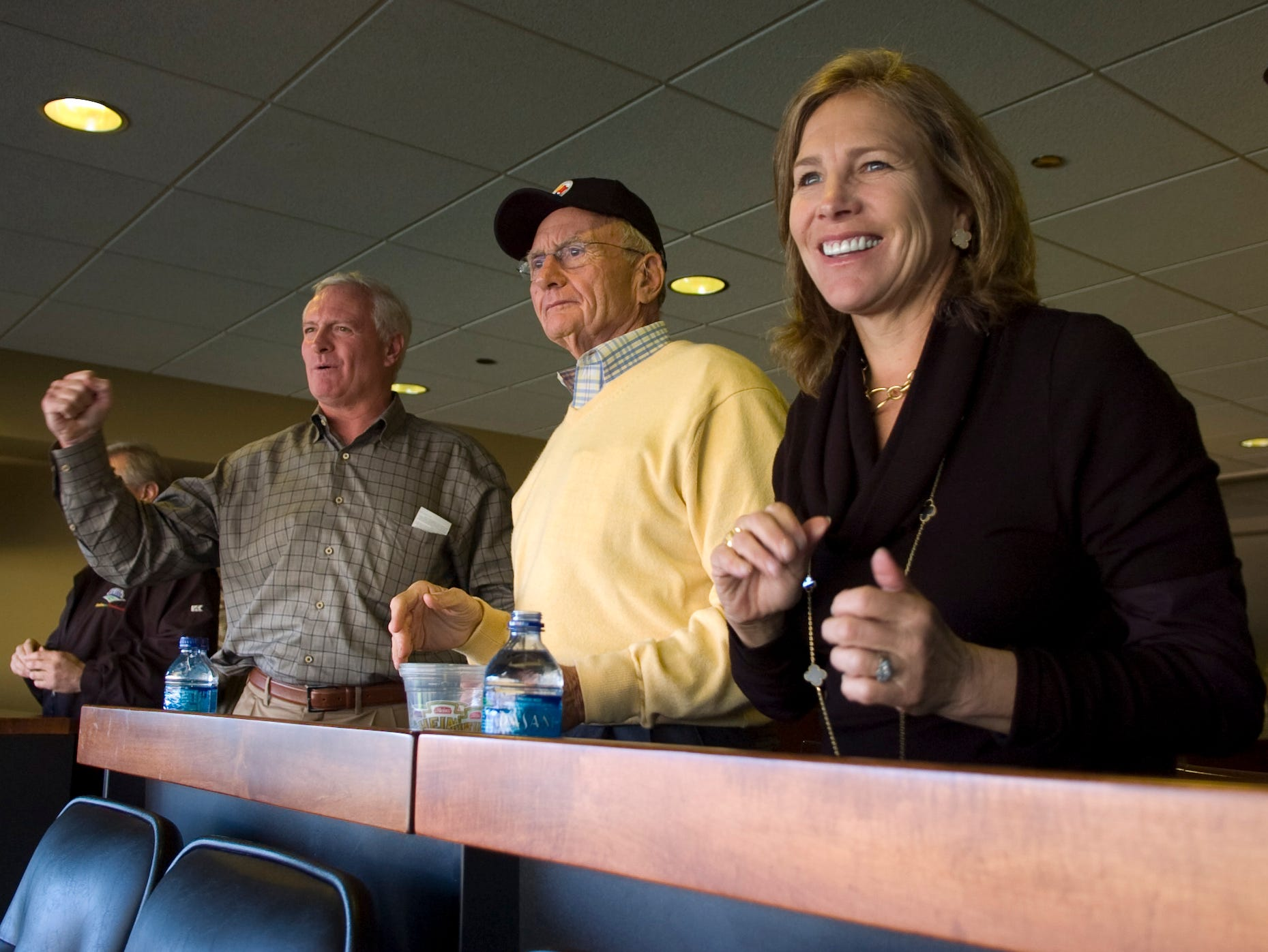 Jimmy Haslam, president and CEO of Pilot Travel Centers, with father Jim Haslam, founder and Chairman of Pilot Corp., and Dee Haslam watch the Pittsburgh Steelers play the Oakland Raiders in Pittsburgh on Nov. 21, 2010. Jimmy Haslam became a partner in the Pittsburgh Steelers in 2008.