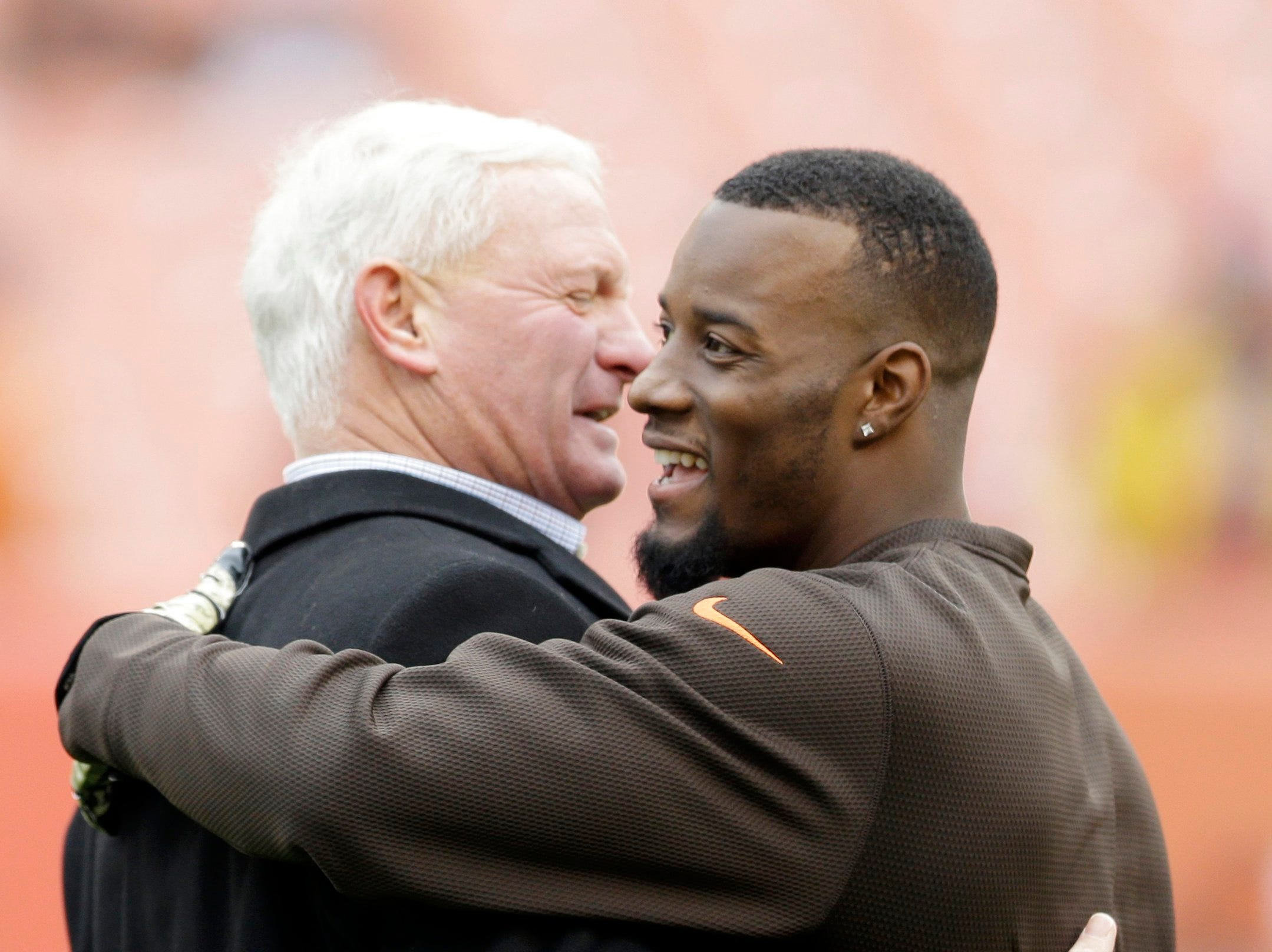 Cleveland Browns owner Jimmy Haslam, left, greets Cleveland Browns free safety Tashaun Gipson before an NFL football game against the Houston Texans Sunday, Nov. 16, 2014, in Cleveland.