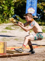 """Gavin Whitson takes part in a challenge on """"Survivor: Edge of Extinction."""""""