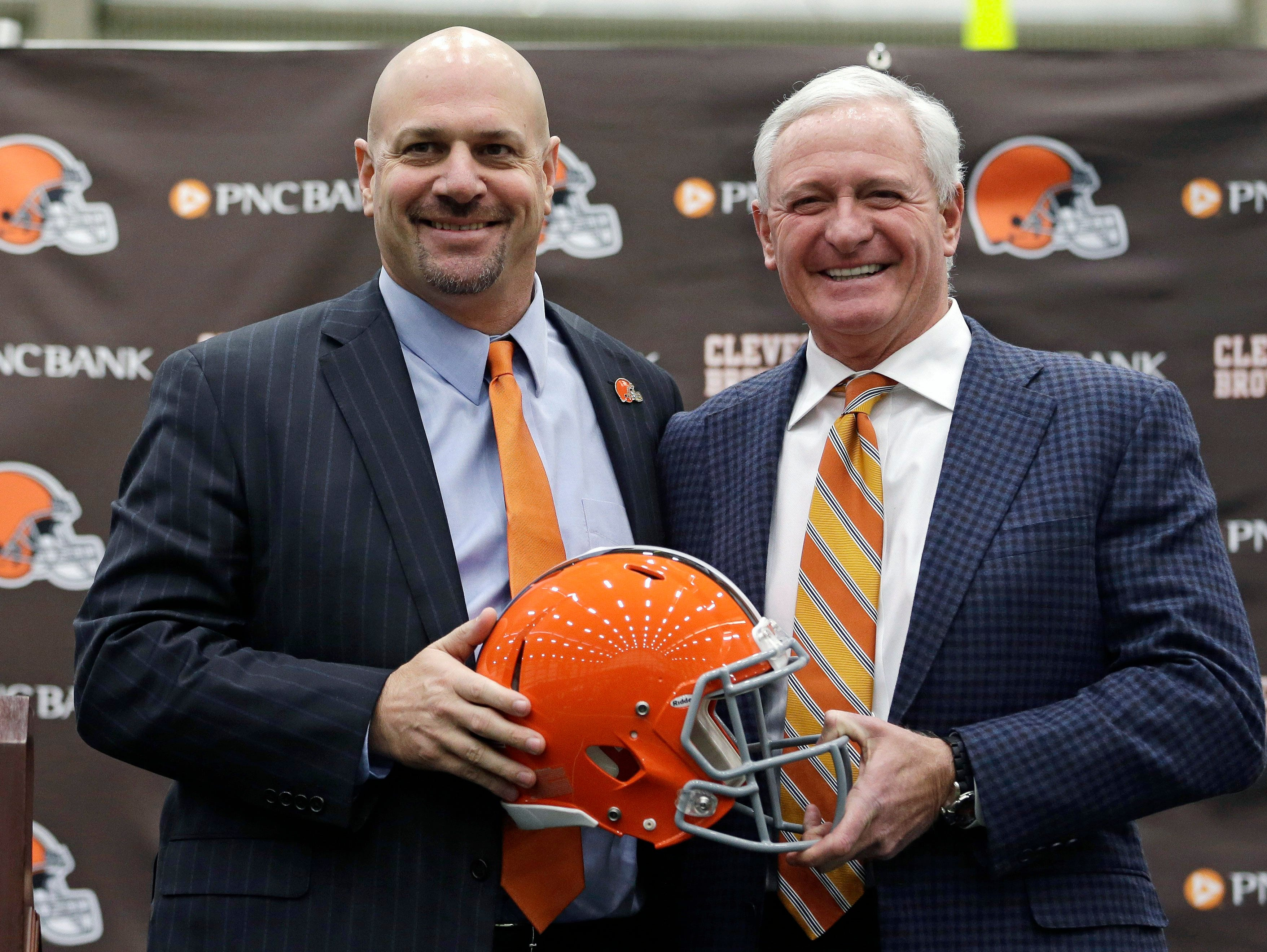 Cleveland Browns head coach Mike Pettine, left, poses with owner Jimmy Haslam after being introduced to the media Thursday, Jan. 23, 2014, in Berea, Ohio. Buffalo's defensive coordinator, who met with team officials for the first time just a week ago, finalized a contract Thursday to become the Browns' seventh full-time coach since 1999.