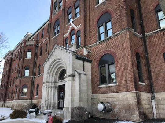 Franciscan Health Lafayette plans to take down three buildings on its former St. Elizabeth Hospital campus, including this entrance to the original wing near Hartford and 14th streets in Lafayette's north end.