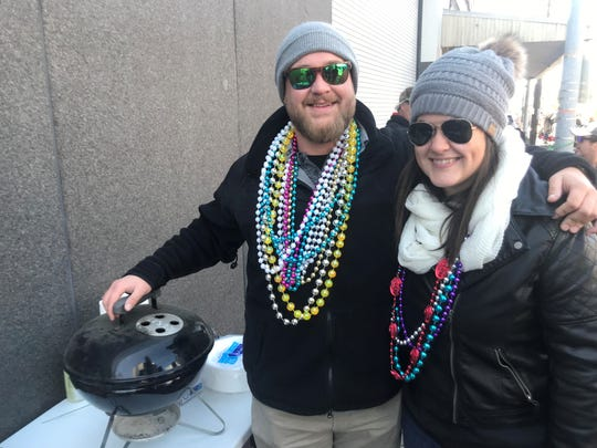 Brandon Johnson and Olivia Jeanmard snagged a sweet spot along the King Gabrial Parade route Tuesday.