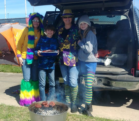Shawn Trahan, Krista Trahan, Zavier Letner and Braylin Trahan are tailgating before the King Gabriel's Parade in Lafayette this morning.