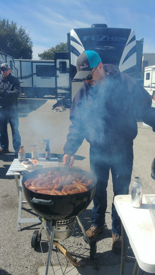 Jack Thibodeaux, of the Campahnaters RV club from Carencro, grills lunch for club members.