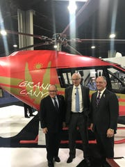 Louisiana Economic Development Secretary Don Pierson, Kopter CEO Andreas Löwenstein and Gov. John Bel Edwards announced an expansion in Lafayette during a helicopter trade show in Atlanta Tuesday.