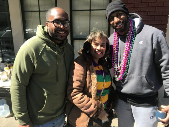 Darrell Benjamin, left, and Phillip Jean-Louis flank Linda Benjamin, who started the 'family tradition' over 50 years ago.