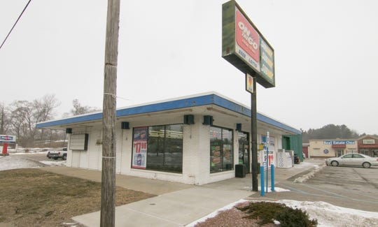 The On the Go party store and adjoining Auto One Glass & Accessories businesses, shown Tuesday, March 5, 2019, will likely move across Grand River Avenue in Howell Township as Grand River Mini-Storage, positioned behind the two shops gears up to expand.