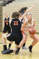 Brighton's Sydney Hetherton scored a game-high 12 points in a 59-19 district basketball victory over Pinckney.