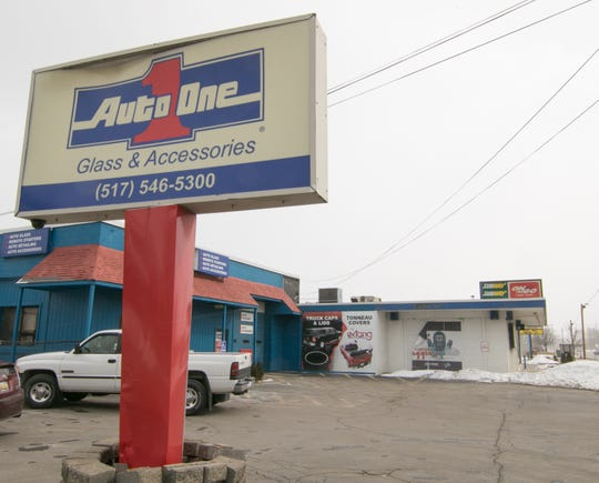 The former Auto One Glass & Accessories and the adjoining On The Go party store are shown Tuesday, March 5, 2019.