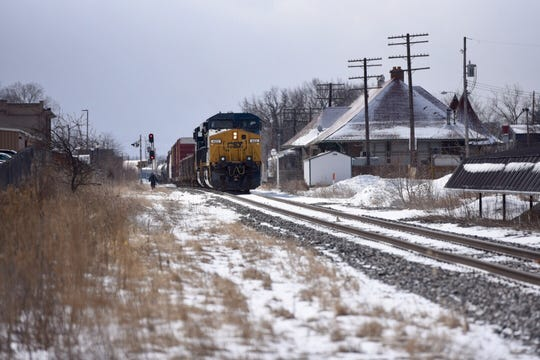 Police are on the scene of where a pedestrian was hit by a train Tuesday in Lansing.