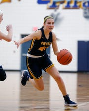 Pewamo-Westphalia's Ellie Droste drives against Ithaca in their district opener, Monday, March 4, 2019, in Westphalia, Mich. P-W won 52-23.