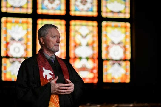 Rev. Mark Thompson, an openly gay pastor at Central Methodist Church in Lansing, poses for a portrait in the church sanctuary, Monday, March 4, 2019.