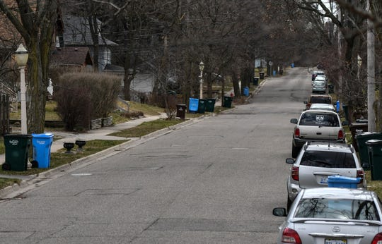 Vehicles are parked along Magnolia Avenue near East Michigan Avenue in 2018. East side neighborhood residents say business growth on Michigan Avenue is causing more parking on side streets.