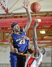 Eastern's LaDontae Henton blocks a shot.