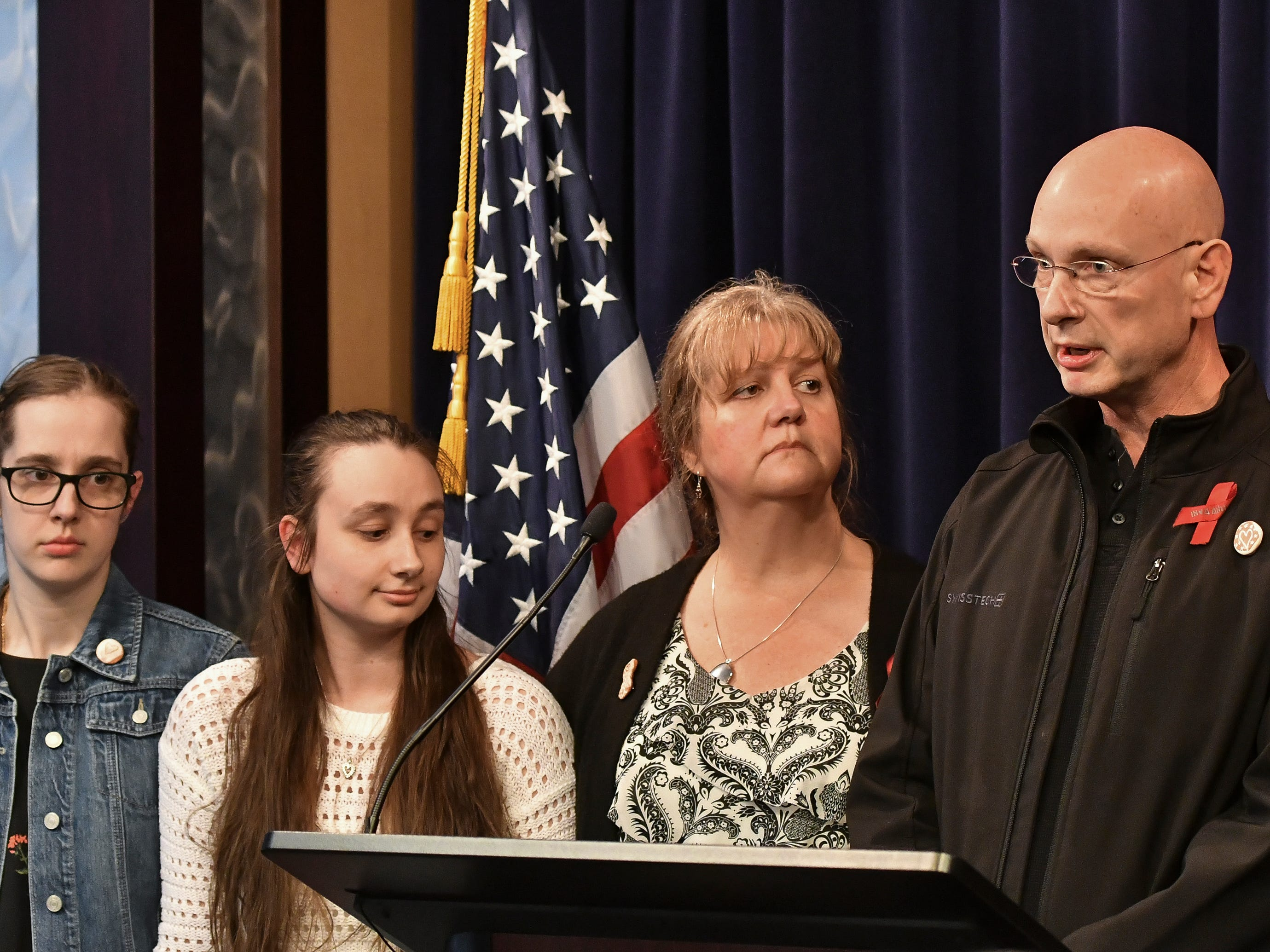 The family of Danielle Stislicki (from left Holly, Jillian, Ann and Richard) thank law enforcement and the Attorney General's office for their work, Tuesday, March 5, 2019, in downtown Lansing.  Attorney General Dana Nessel filed first degree pre-meditated murder against Floyd Galloway, Jr., for the murder of Danielle Stislicki.  The 28-year-old disappeared from a parking lot in December 2016 and has never been found.