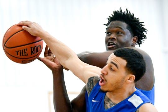 Great Lakes Christian College center Basit Seidu, top, and teammate Kais McCook go for a rebound during practice on Friday, March 1, 2019, at the Doty Center on campus in Lansing. The men's basketball team left for the NCCAA DII Men's Basketball National Tournament in Greenville, South Carolina, on Monday.