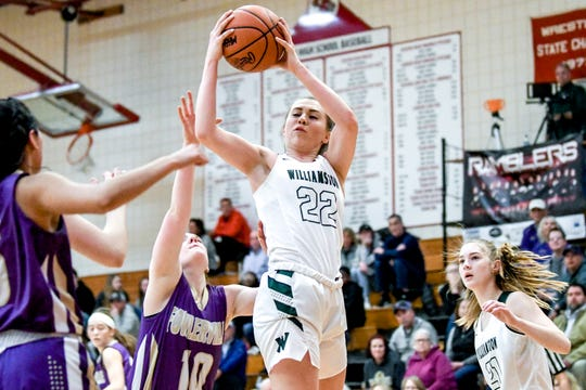 Williamston's Kenzie Lewis, center, pulls down a rebound in front of Fowlerville's Franny Updike during the fourth quarter on Monday, March 4, 2019, at Perry High School.
