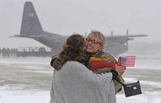 Staff Sgt. Cameron Dodge of Geneva, Ohio gets a hug from her mother, Deanna Dodge after she returned Tuesday afternoon from the Middle East.