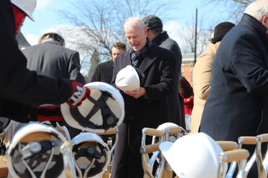 Warren Harding III, grandnephew of the president by the same name, dons a hard hat before posing for pictures at a ground-breaking ceremony for the Warren G. Harding Presidential Center, what is expected to be a roughly 12,000-square-foot museum just north of the Harding Home.