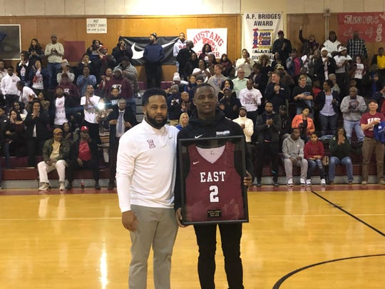 March 4, 2019 - Memphis freshman Alex Lomax stands with East High School coach Jevonte Holmes at his jersey retirement.