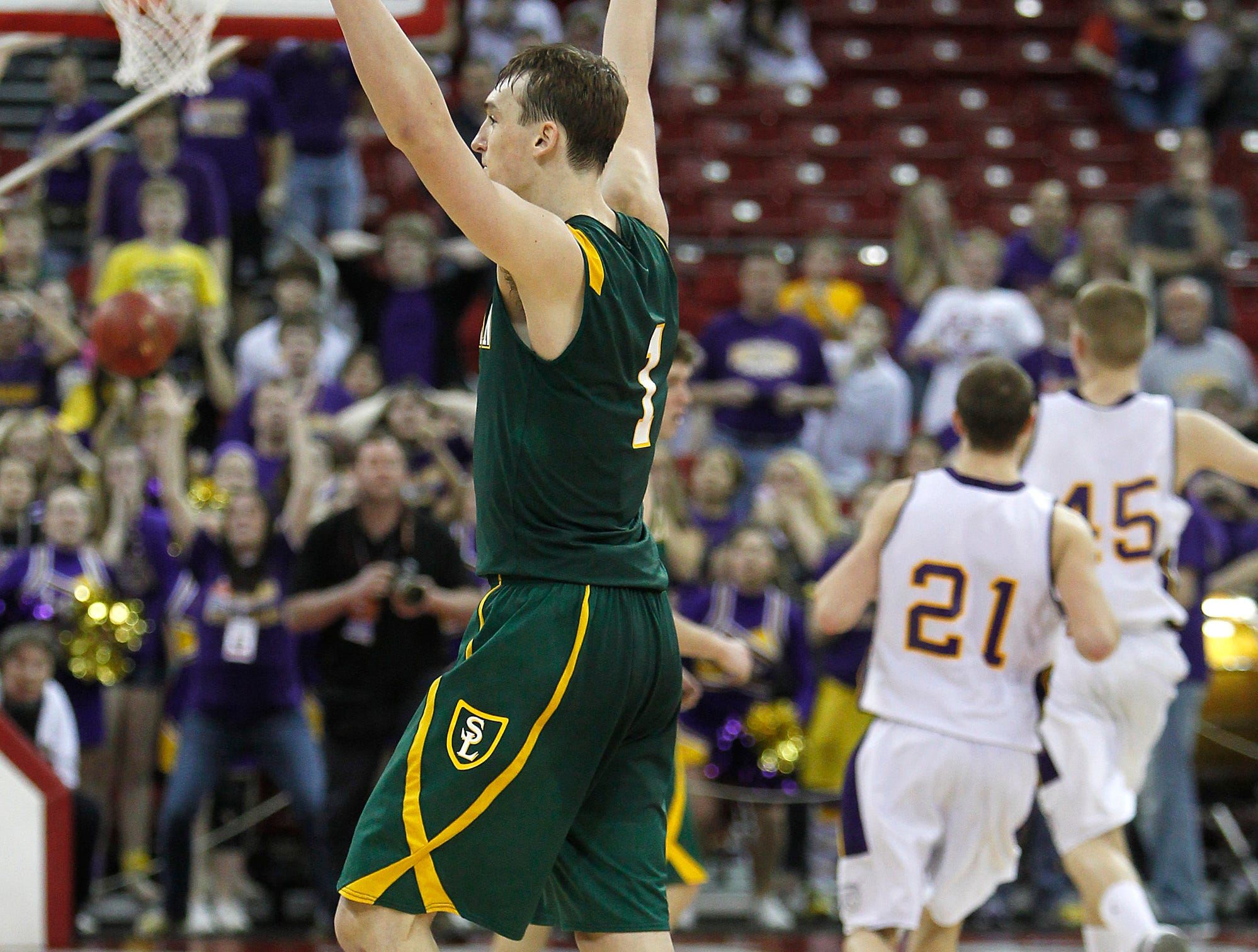 Sheboygan Area Lutheran #1 Sam Dekker his three pointer at the buzzer to defeat Racine Lutheran for the 2012 Division 5 state championship at the Kohl Center in Madison.