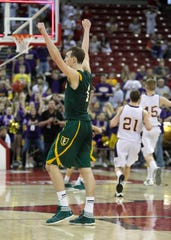 Sheboygan Lutheran's Sam Dekker celebrates his three-pointer at the buzzer to defeat Racine Lutheran for the 2012 Division 5 state championship at the Kohl Center in Madison.