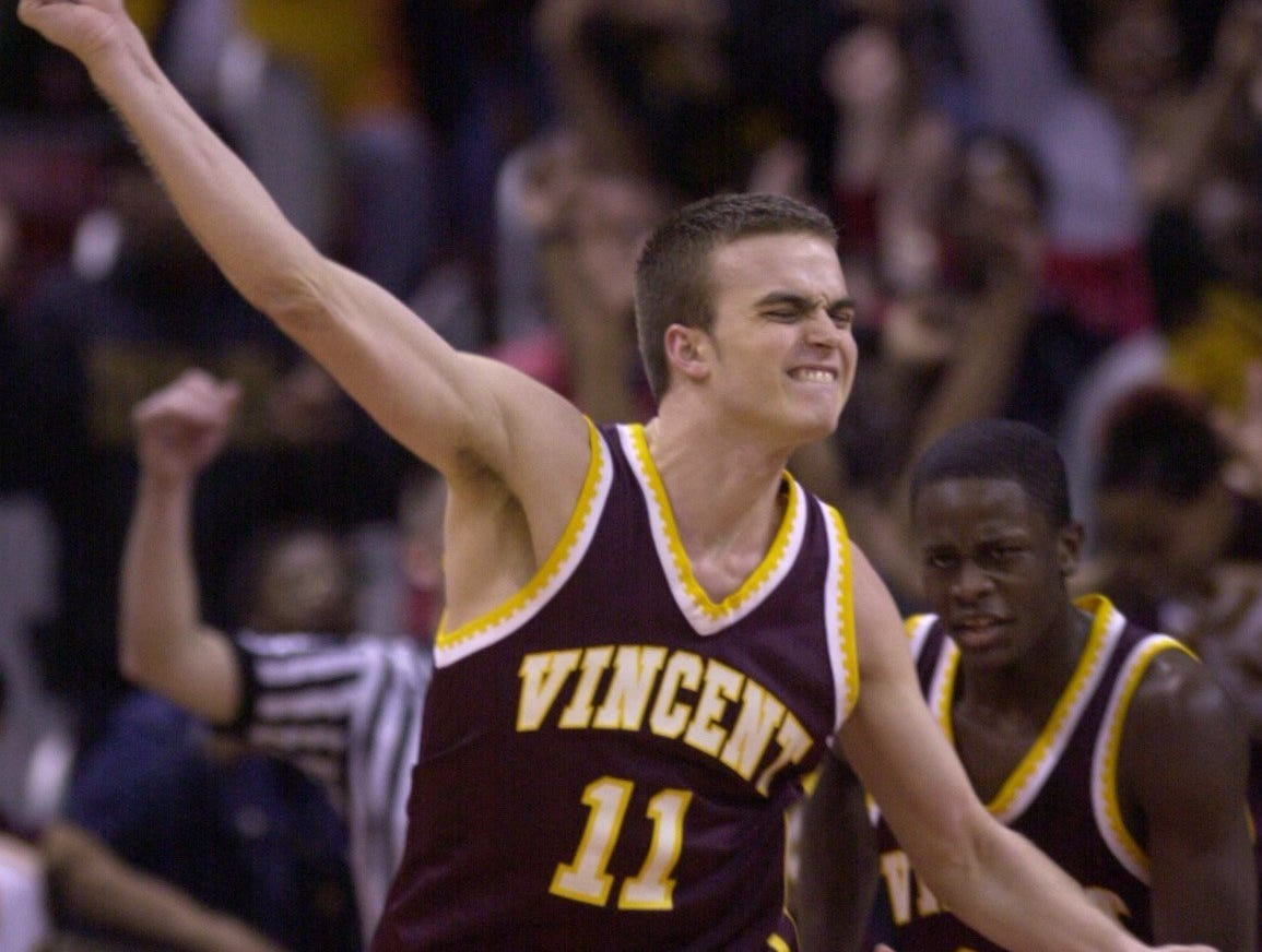 Milwaukee Vincent's #11 Marcus Conigliaro reacts after sinking a three pointer in the fourth quarter to give Vincent an 11-point lead en route to the the 2001 Division 1 Championship aginst Oshkosh West.