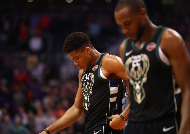 Bucks forwards Giannis Antetokounmpo and Khris Middleton are surprised by the Phoenix Suns for the second time this season.