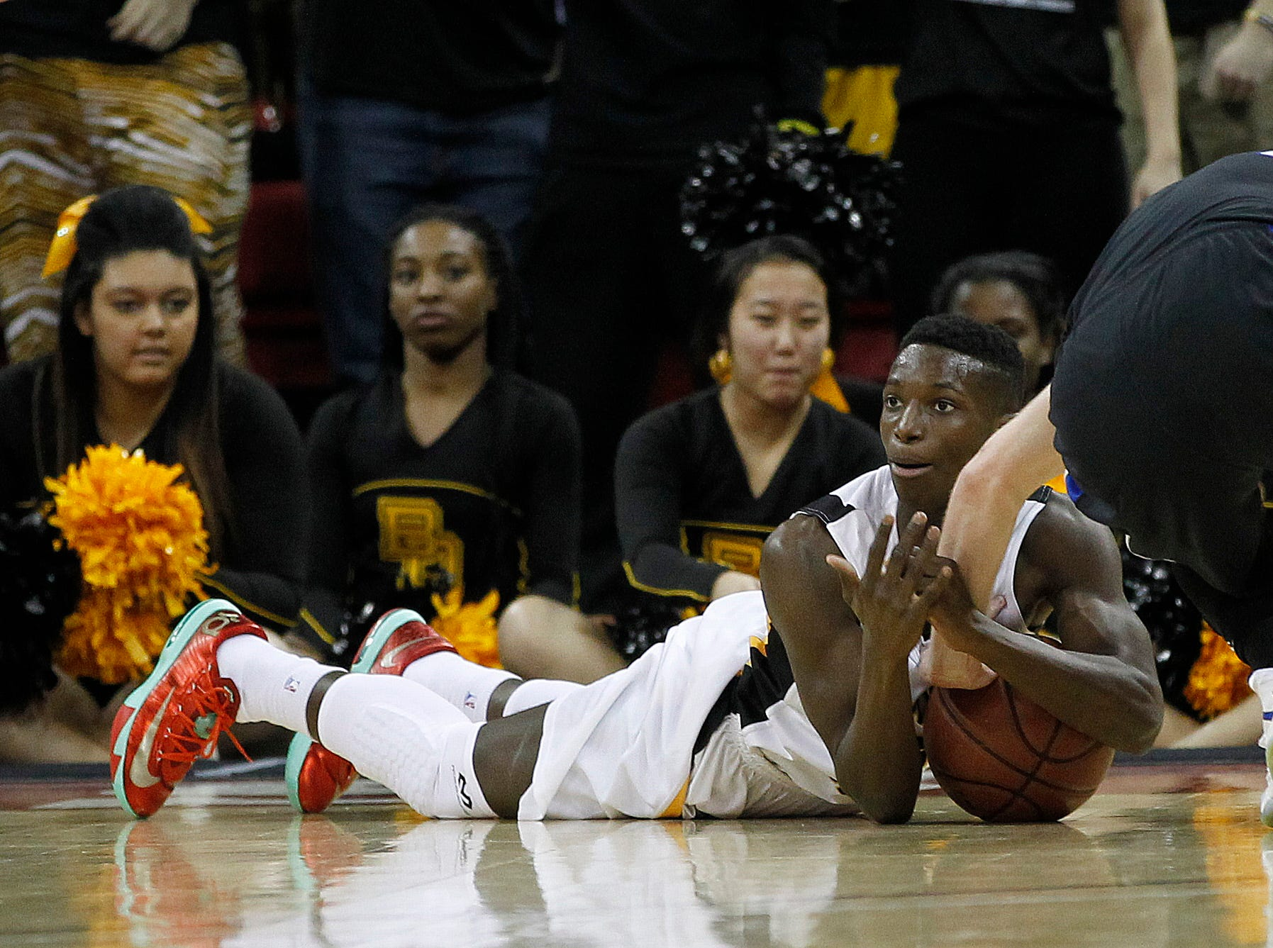 Brown Deer's Lewrenzo Byers goes for a loose ball against the Lodi Blue Devils' in the second period of the 2014 Division 3 WIAA Boys Basketball Tournament Championships being held at the Kohl Center in Madison.