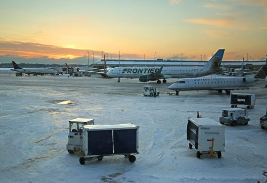 Passenger aircraft maneuver on the frozen, snow-dusted tarmac at Milwaukee Mitchell International Airport on Feb. 13, 2019.  A rough winter and a concentration of spring breaks all in the same week will send throngs of travelers to the airport between now and Easter on April 21, 2019.
