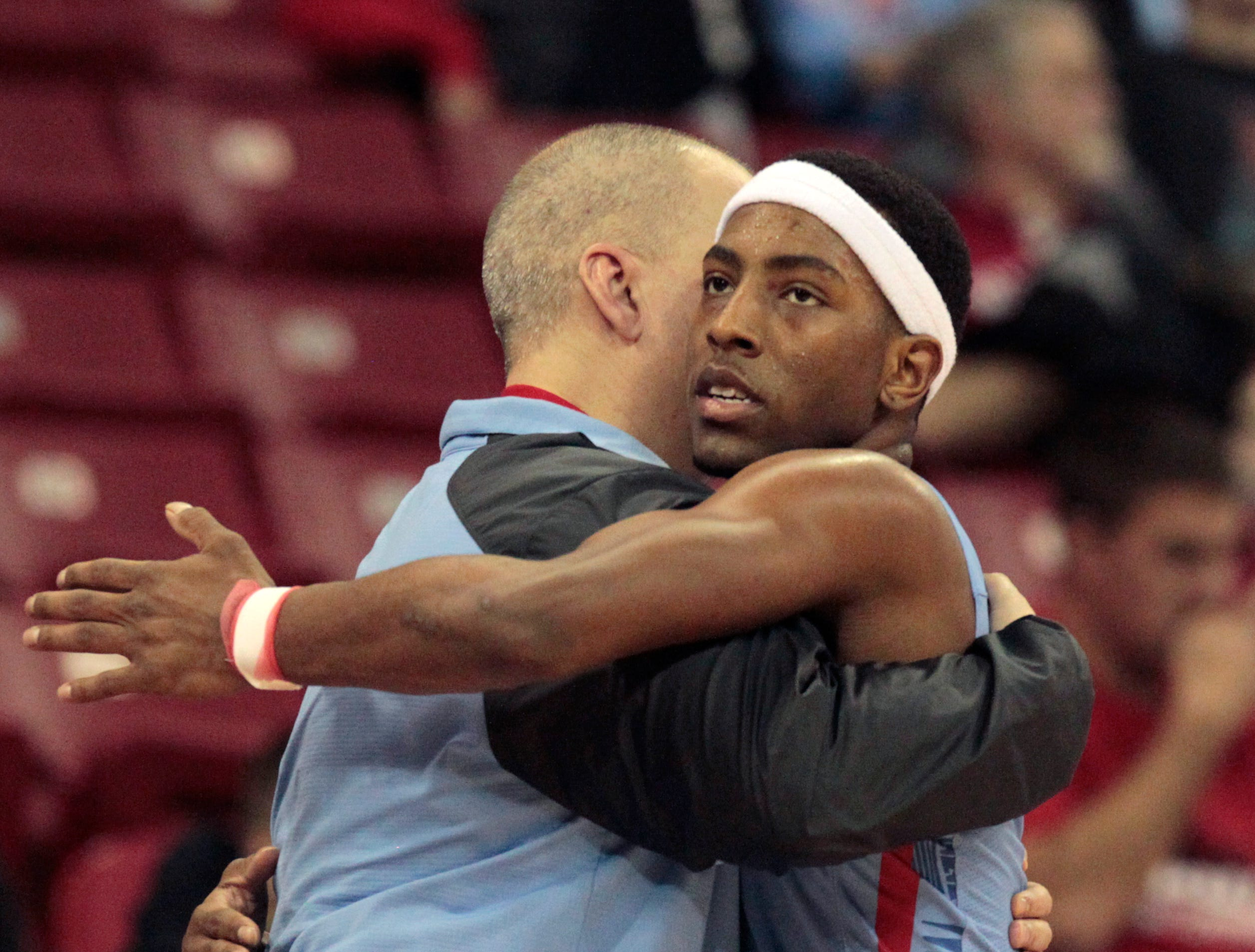 Arrowhead's Trevell Cunningham (2) hugs coach Craig Haase after their loss to Stevens Point in  the Division 1 championship game at the 2017 WIAA boys' state basketball championships.