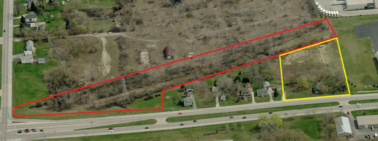 A county-owned parcel (outlined in red) would be sold to a development firm for $1 in connection with its plans to build affordable apartments at an Oak Creek site (outlined in yellow).