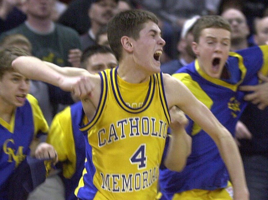 Waukesha Catholic Memorial's #4 Griffin LaDew celebrates his game winning three-point shot to break a tie in the 2004 Divison 2 championship game.