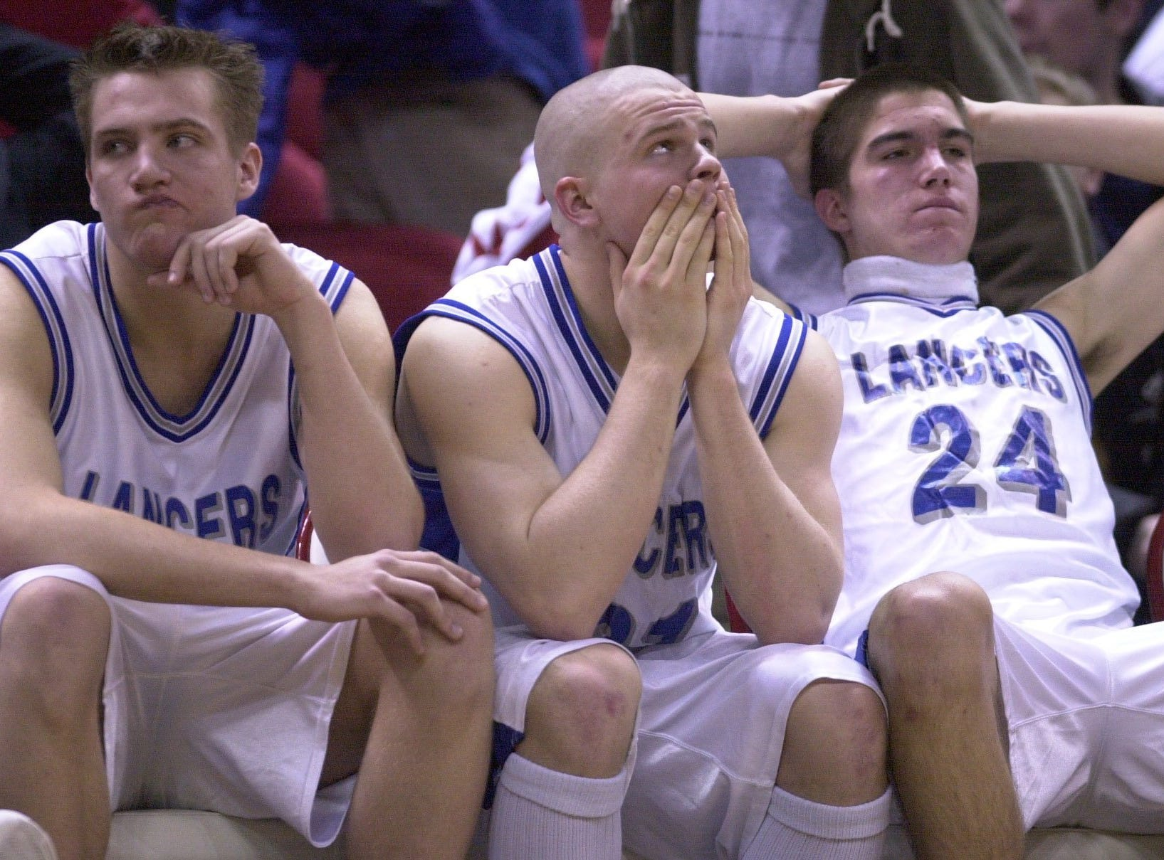 Brookfield Central players Adam Dahlke (left), Darryl Schnell andTodd Ciborowski watch the final seconds of the game tick down to a 44-39 loss to Fond du Lac in the 2002 WIAA state semifinals.