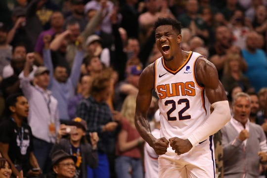 Suns center Deandre Ayton celebrates a victory over the Milwaukee Bucks.
