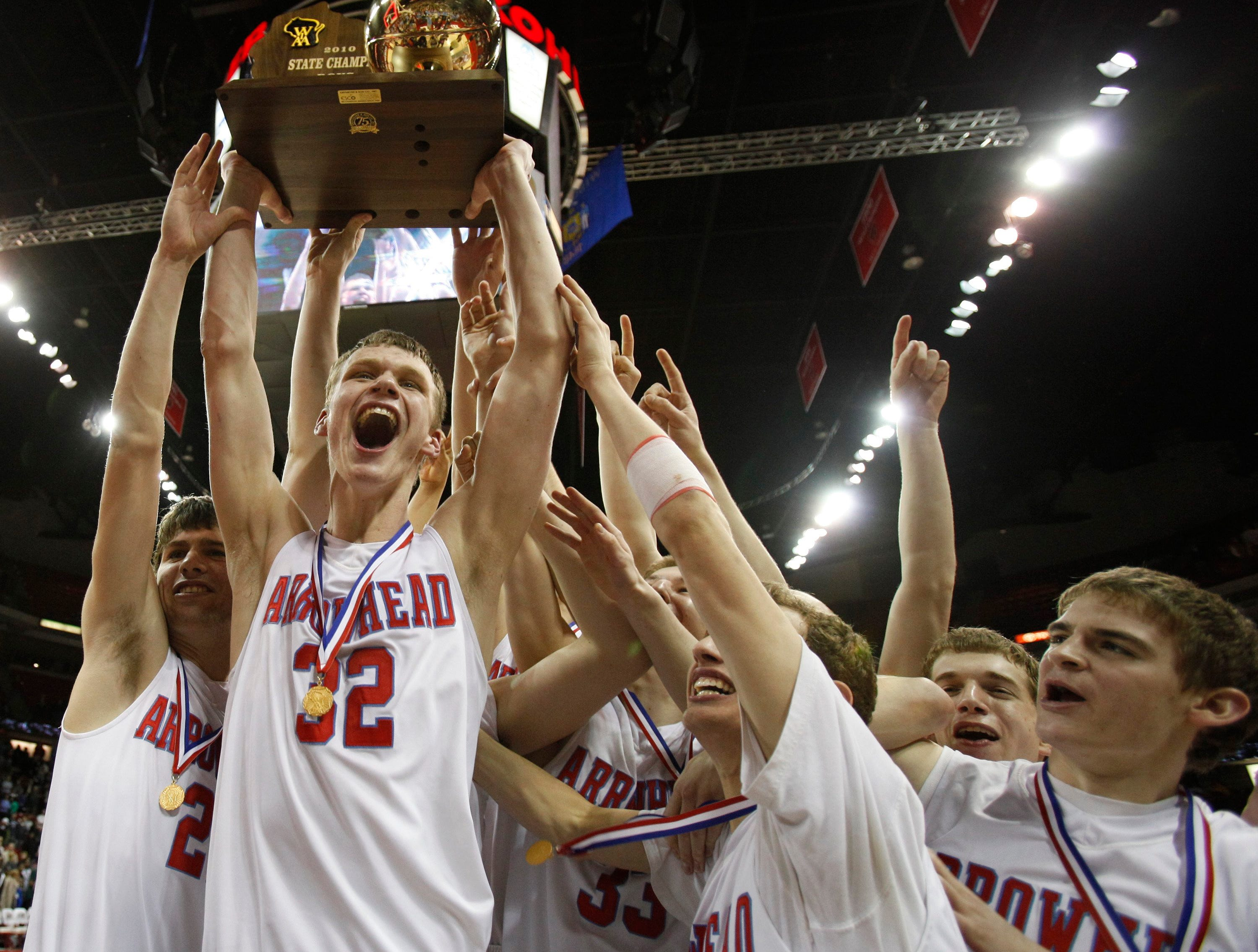 Arrowhead's Michael Skarie, left, Ben Mills (32), Charles Rushman (33) and Jonny Fischer celebrate winning the 2010 Division 1 championship WIAA state tournament basketball game against Madison Memorial.