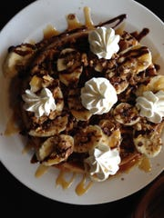 Cafe Agora's menu features a variety of breakfast and lunch options including the pecan caramel banana waffle.