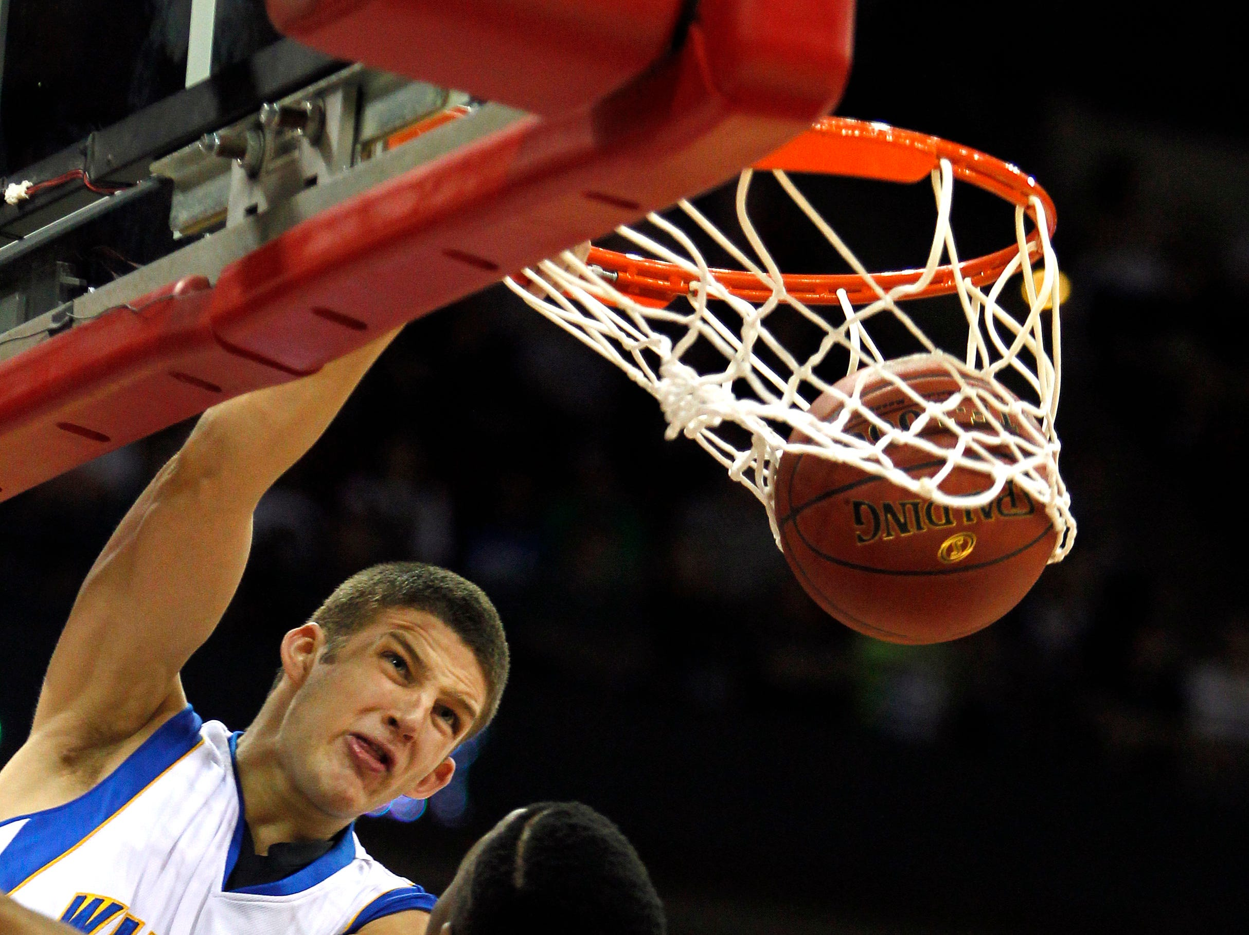 Germantown's Zak Showalter takes the opening tip for a dunk over Madison Memorial's #30 Jamar Morris at the WIAA boys state basketball tournament held at the Kohl Center in Madison, WI Friday March 16, 2012.