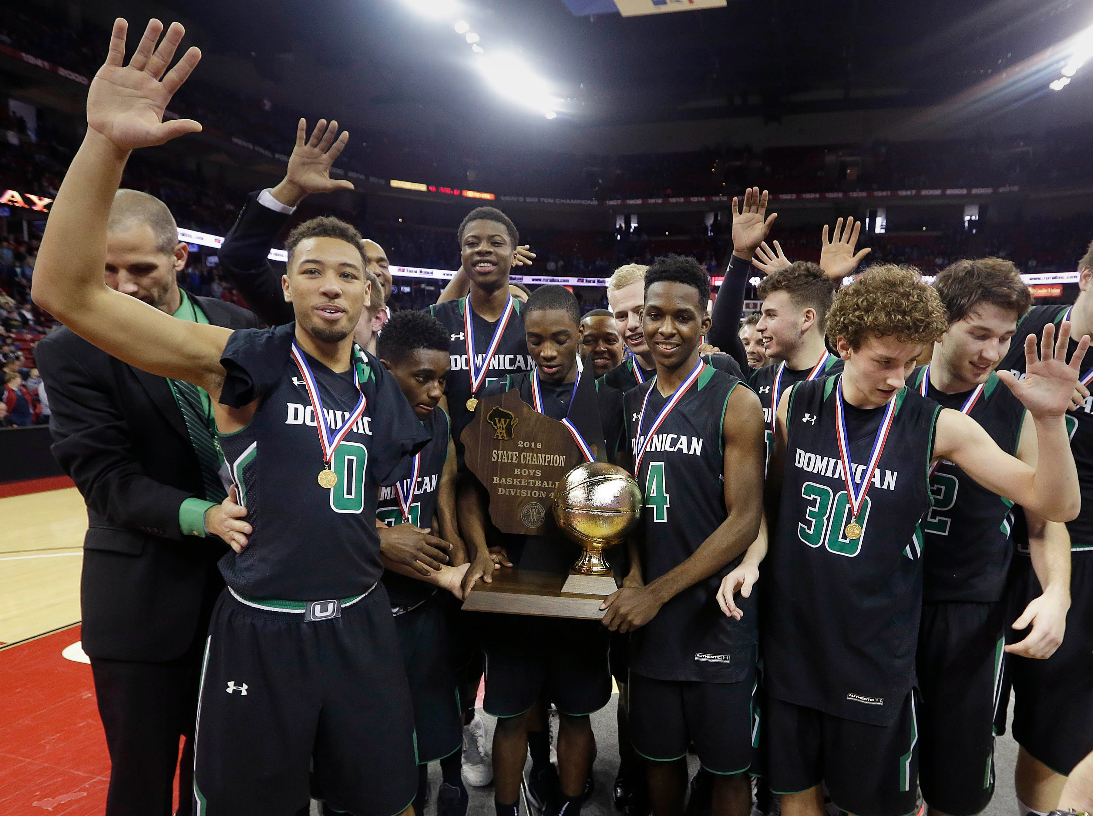 Dominican shows off their trophy after after Dominican's 62-43 win over Cameron in 2016 to win their fifth  D4 Championship in the WIAA State Boys Basketball Tournament