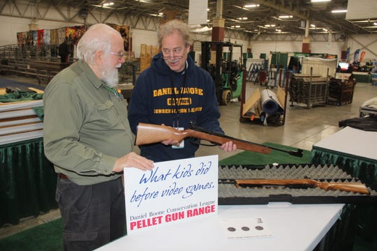 Jay Brown, right, and Gary Kuzdas, both members of Daniel Boone Conservation League, prepare the club's air rifle range Tuesday at the Milwaukee Journal Sentinel Sports Show.