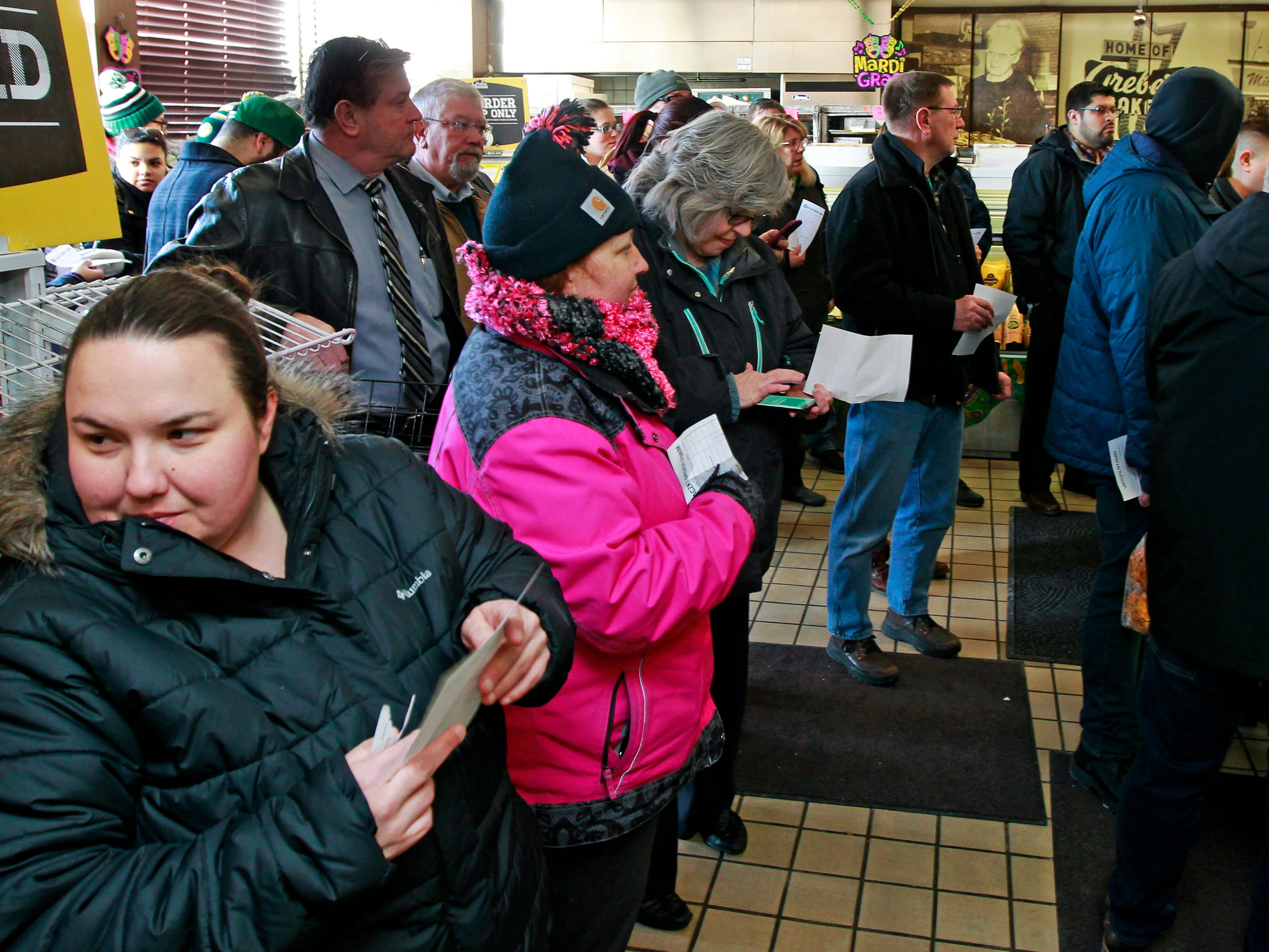 Early morning customers wait patiently at Grebe's Bakery in West Allis for their Fat Tuesday tradition, paczki.